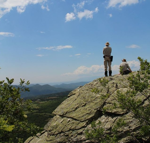 SCS tour photo - participants admiring the view from a high rock