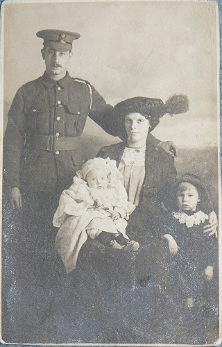Photograph of Sidney James Robinson (4/KRRC) with his wife, Alice, and sons, Sidney and William, probably taken in autumn 1914.