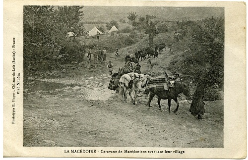 A French published postcard showing a caravan of Macedonians evacuating their village, although it gives no clue when and where this took place. From the collection of Kate and Martin Wills.