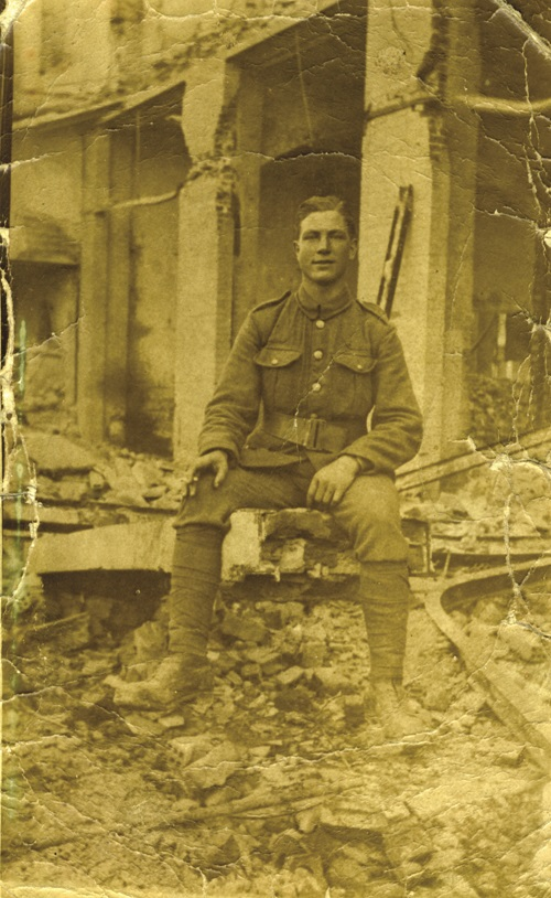 Private Bill Devereux, 11th Battalion Worcestershire Regiment, sitting in the ruins of Salonika after the Great Fire of August 1917. Photograph provided by his grandson, Richard Devereux.