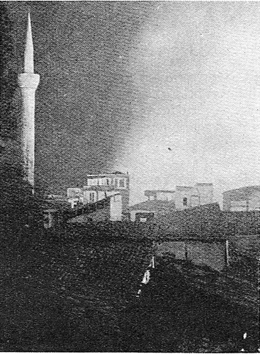 French Official photograph: FLOOD-LIT BY A CITY'S FIRE. This remarkable photograph of the great fire at Salonika in August 1917 shows the Turkish quarter burning. The minaret on the left id flood-lit by the flames which leapt high in the air and made an awe-inspiring spectacle by night.