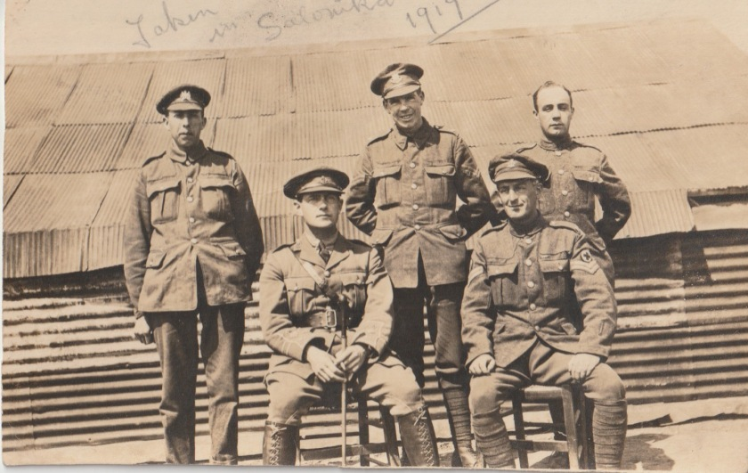 A group photo taken in Salonika, 1917. Back row (l-r): Private, Manchester Regiment (or is it the General List cap badge?); Corporal, Worcestershire Regiment (11th Bn); Private, no distinguishing badges. Front row (l-r): Captain, RAMC; Corporal, RAMC. On the back: 'Fondest love to Mary, Salonica, May 1st 1918'.