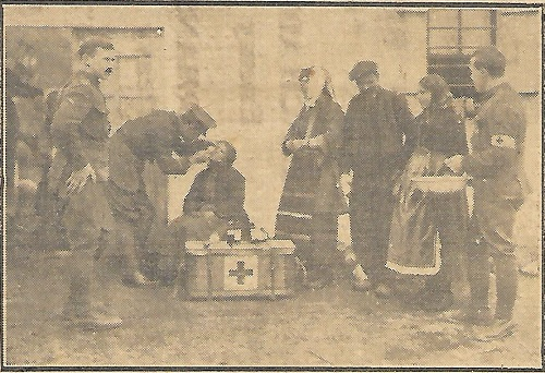 Press photo from 1916 showing the Medical Officer and orderlies of 12/A&SH treating Macedonian villagers. It includes Lance Corporal Andrew Reid from Ayrshire.