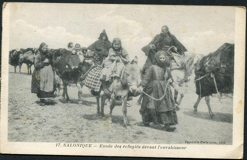 A French published postcard showing refugees 'fleeing before the invader' although it gives no clue when or where this took place. From the collection of Kate and Martin Wills.