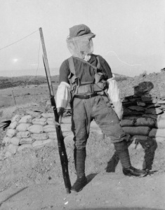 Lance Corporal Harrison (12th Lancashire Fusiliers) wearing full anti-mosquito PPE in June 1918 (Private Collection)
