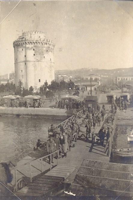 A splendid view of Salonika's White Tower taken from a ship, showing RAMC ambulances waiting. A photo belonging to Corporal Herbert Beacock RAMC.