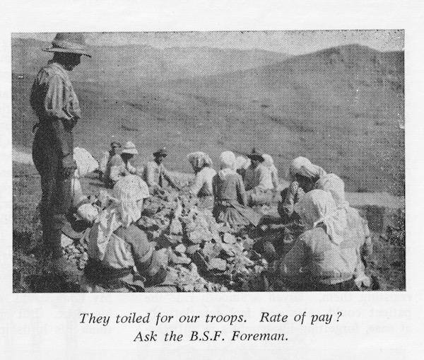 A photograph from 'The Mosquito' showing local labourers - mainly women - breaking rocks for us in road mending.